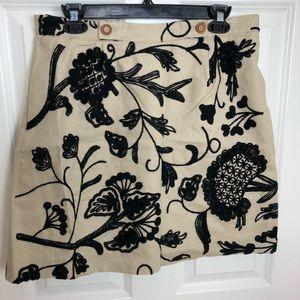 Anthropologie tan and black floral mini skirt